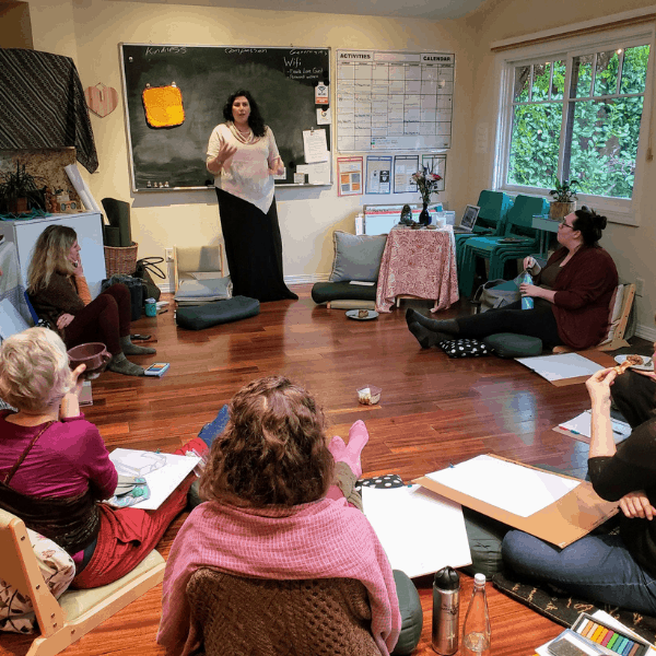 Maeve Sundstrom teaching a class of professionals.