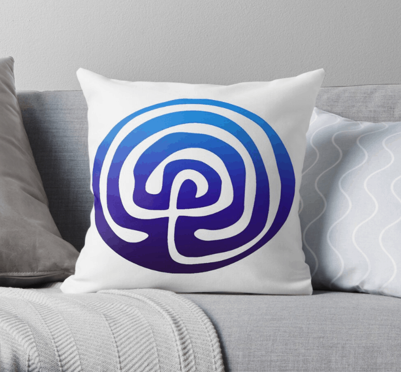 white pillow imprinted with a blue Birthing From Within labyrinth
